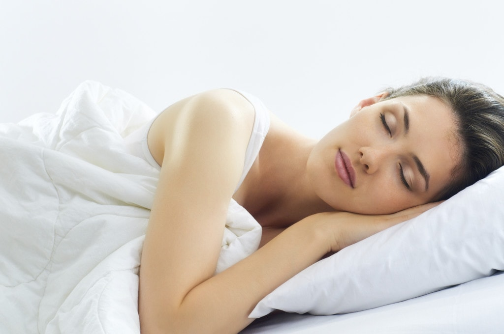 Young woman sleeping soundly thanks to her oral appliance which is an alternative to intrusive CPAP machines.