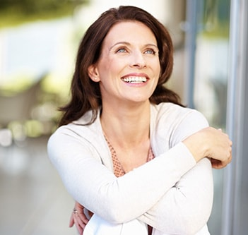 A woman smiling with straight teeth from Invisalign and Northstar Dentistry for Adults in Huntersville