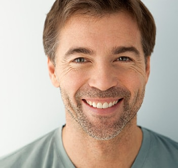 A man smiling after mercury free dentistry from Invisalign and Northstar Dentistry for Adults in Huntersville