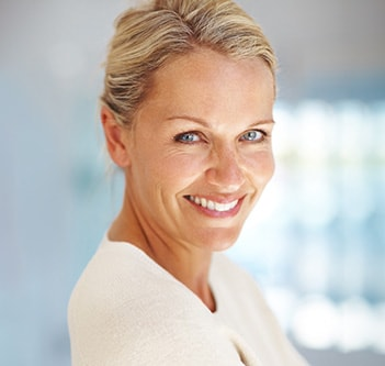 A woman smiling with porcelain veneers from Invisalign and Northstar Dentistry for Adults in Huntersville