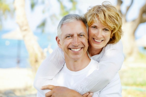 Image of smiling older couple who enjoy Huntersville NC dental services