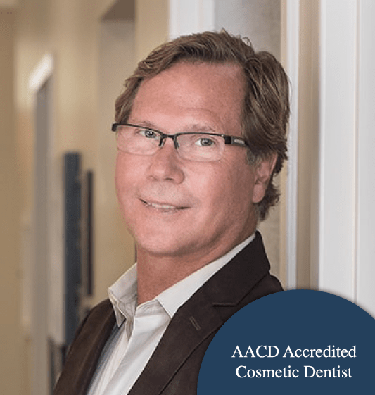 Dr. John Merrill with that badge that he's an Accredited AACD Cosmetic Dentist in Huntersville, NC.